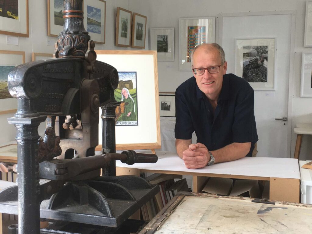 Photo of Peter Ursem with his Victorian Hopkinson & Cope Albion printing press